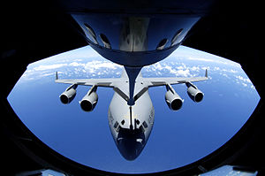 Aerial refueling - A C-17 Globemaster refuels through the boom of a Boeing KC-135 Stratotanker.