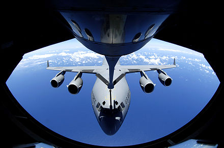 A C-17 Globemaster refuels through the boom of a Boeing KC-135 Stratotanker. - Aerial refueling