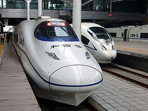 High-speed rail in China - A CRH2C (left, based on E2-1000 Series Shinkansen) and a CRH3C (right, based on Siemens ICE 3) train at Tianjin Station.