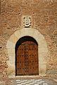 Campillo de Altobuey, Ermita de San Roque, puerta con escudo.jpg