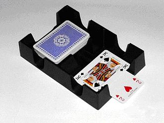 Cut (cards) - A Canasta tray used in cutting and dealing