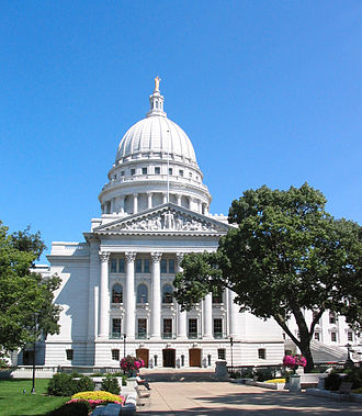 The Wisconsin State Capitol is located on the isthmus between Lake Mendota and Lake Monona, in the city of Madison. Capitol Madison, WI.jpg