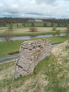 View of the ruins of Roxburgh castle, open country with the River Tweed and, in the distance, Floors Castle.