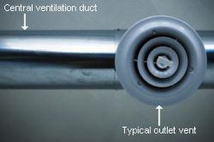 Duct (flow) - A round galvanized steel duct connecting to a typical diffuser