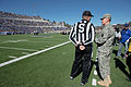 Chairman of the Joint Chiefs of Staff Gen. Martin E. Dempsey talks with a sideline judge during the Army versus Air Force football game at Falcon Stadium in Colorado Springs 131102-D-KC128-773.jpg
