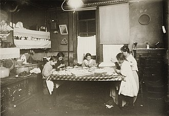 Child labour - Early 20th century witnessed many home-based enterprises involving child labour. An example is shown above from New York in 1912.