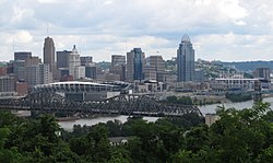 Downtown Cincinnati from Devou Park, seen from across the Ohio River in Covington, Kentucky. The Carew Tower, the city's second-tallest building, is to the left, to its right is the PNC Tower. The stadium on the left is Paul Brown Stadium, home to the NFL's Cincinnati Bengals; on the right is the Great American Ball Park, home to MLB's Cincinnati Reds. The skyscraper at the right is the Great American Tower at Queen City Square, now the tallest building in the city and the third tallest in Ohio.