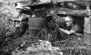United Nations Operation in the Congo - Swedish UN soldiers armed with sub machine guns at one of the access roads to Niemba in November 1961.