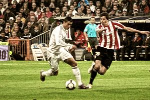 El Viejo Clásico - Real Madrid's Cristiano Ronaldo (left) and Athletic Bilbao's Ander Iturraspe during a match at Santiago Bernabéu Stadium, 2010