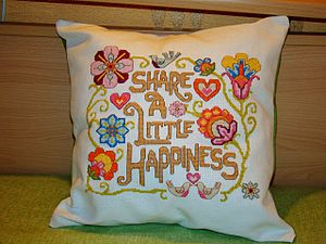Cross-stitch - A pillow embroidered and made by the use of cross-stitching.