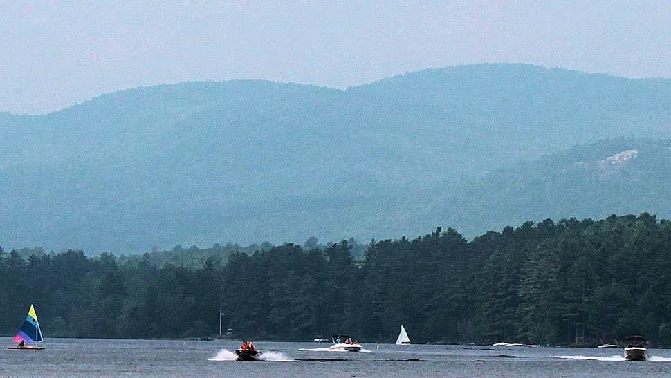 Crystal lake in the summer with gunstock moutain in the background