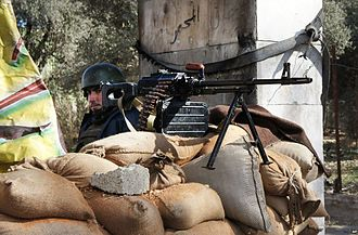 A Syrian Army soldier manning a checkpoint outside of Damascus shortly after the outbreak of the Syrian Civil War, 2012 VOA Arrott - A View of Syria, Under Government Crackdown 08.jpg