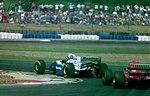 Damon Hill - Williams FW16 leads Jean Alesi - Ferrari 412T1B at the 1994 British Grand Prix (31697717364).jpg