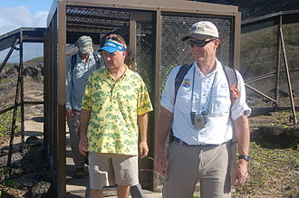 Kaena Point - USFWS Director Dan Ashe entering Kaena Point State Park through a mantrap-style gate in the predator proof fence.