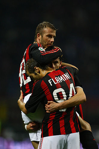 Mathieu Flamini - Flamini with David Beckham and Filippo Inzaghi in action for Milan, celebrating a goal against Torino in the Serie A, at the San Siro.