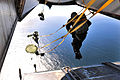 Defense.gov News Photo 101208-N-7643B-401 - U.S. Navy Explosive Ordnance Disposal technicians with Explosive Ordnance Disposal Mobile Unit 11 Detachment 15 perform a static line water drop.jpg