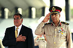 Defense.gov News Photo 111004-F-RG147-193 - Secretary of Defense Leon Panetta stands beside Egyptian Maj. Gen. Rouini during the playing of the U.S. national anthem at the Tomb of the Unknown.jpg