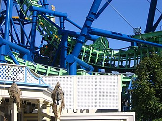 Giant Inverted Boomerang - Déjà Vu at Six Flags Great America, with passengers waiting mid-ride after emergency brakes engaged.