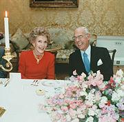 Denis Thatcher laughs with Nancy Reagan