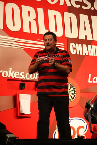 """Dennis the Menace and Gnasher - Darts player Dennis """"The Menace"""" Priestley wearing the character's red and black striped colours"""