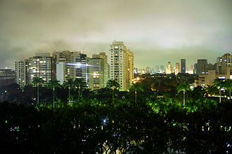 Esporte Clube Pinheiros - Nocturnal view across the greenery of the club, to apartment blocks along Rua Angelina Maffei Vita.