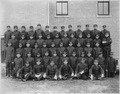 Early class of young men in uniform at the Albuquerque Indian School. - NARA - 292870.tif