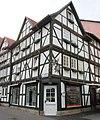 """Eckfachwerkhaus des frühen 17. Jh mit """"Wilden Mannfiguren"""" - Eschweg Ecke Obermarkt (frh. Schuhmarkt)-Marktstraße - panoramio.jpg"""