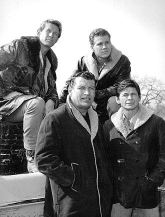 Empire (1962 TV series) - Male cast members clockwise from back: Warren Vanders, Ryan O'Neal, Charles Bronson and Richard Egan, 1963.