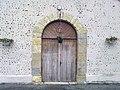 Entrée de l'église de Ségos.jpg