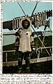 Eskimo man standing in front of fish drying on rack, Alaska, 1906 (AL+CA 1325).jpg