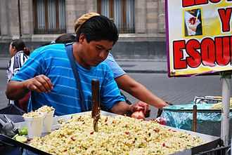 Mexican street food - Esquites being sold from a wandering vendor using a shopping cart