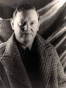 A black-and-white photo of Waugh looking to the camera