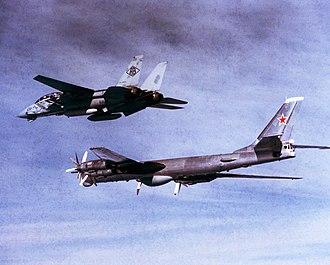 Soviet Air Forces - Soviet Tu-95 escorted by U.S. Navy F-14 Tomcat