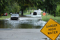 FEMA - 32096 - Cars drives though flooded street in an Oklahoma neighborhood.jpg