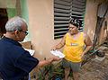 FEMA - 39112 - FEMA Community Relations representative speaks with a resident in Puerto Rico.jpg