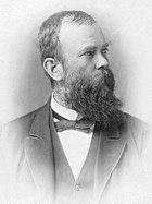 A man with a huge black beard
