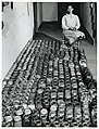 Farm Security Administration client with her canned goods.jpg