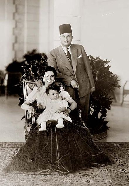 Farouk I with his wife Queen Farida and their first-born daughter Farial (c. 1939)
