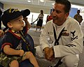 Flickr - Official U.S. Navy Imagery - A Sailor gives a boy a Navy ball cap at the Children's Hospital in Boston as part of Caps for Kids during Boston Navy Week..jpg