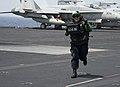 Flickr - Official U.S. Navy Imagery - A Sailor runs across the flight deck of USS Abraham Lincoln..jpg