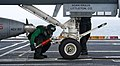 Flickr - Official U.S. Navy Imagery - A Sailors attaches a hold back bar to a fixed wing aircraft..jpg