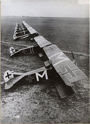 "Carl Menckhoff - Menckhoff's Fokker D.VII of Jasta 72 (marked with prominent letter ""M""s) at Bergnicourt, July 1918"