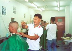 Fourth Class Midshipmen of the Philippine Merchant Marine Academy receiving crew cuts - 2005.jpg