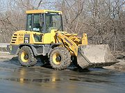 A front loader with articulated steering.