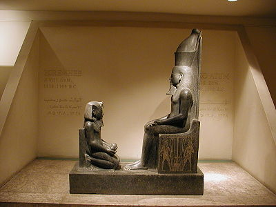 Statue of Horemheb giving offerings to Atum, located within the Luxor Museum, Egypt