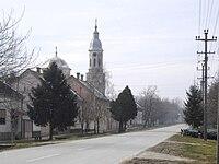 Gardinovci, main street and the Orthodox Church.jpg