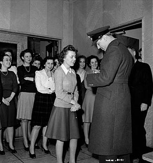 George Beurling - Beurling signing autographs at a war production plant, January 1943