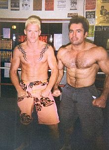 Rogan and Gerald Strebendt flexing in a ring