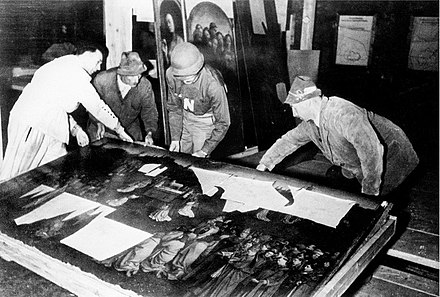 The Ghent Altarpiece during recovery from the Altaussee salt mine at the end of World War II. Ghent altarpiece at Altaussee.jpg