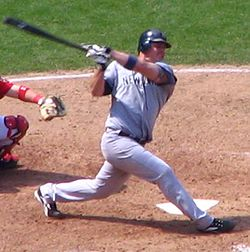 Giambi swings at a pitch in 2006.